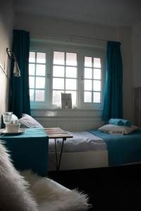 A bed or beds in a room at B&B Hotel Zandvoort