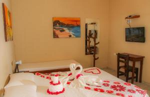 Una cama o camas en una habitación de Pousada Ponta Da Pedra