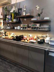 Restaurant ou autre lieu de restauration dans l'établissement Les Ailes
