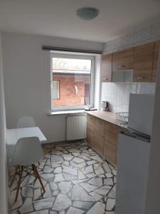 A kitchen or kitchenette at Wesoła Centrum