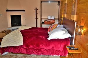A bed or beds in a room at Pousada Oliveri