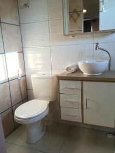 Um banheiro em Pousada Vila Appia