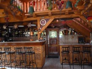 The lounge or bar area at Napkorong Fogadó és Vendégház