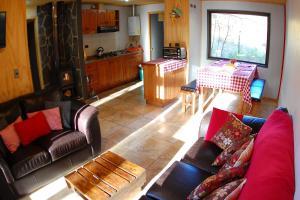 The lounge or bar area at Basecamp Cabañas