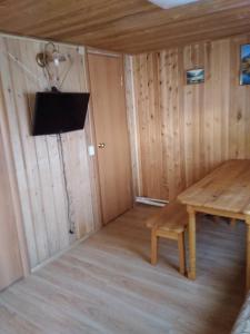 A television and/or entertainment center at Tunkinskaya Dolina Poselok Zhemchug Naran Gol