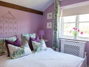 A bed or beds in a room at The Hayloft