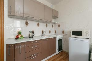 A kitchen or kitchenette at Апартаменты на Одоевского 1-11 на 9 этаже