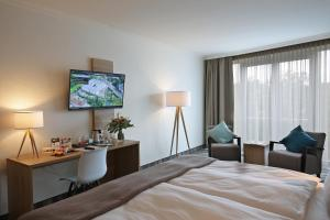 A bed or beds in a room at Quality Hotel Lippstadt