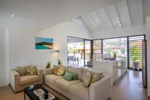 Uma área de estar em La Royal Penthouse Apartment Jan Thiel