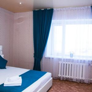 A bed or beds in a room at 1 комнатная квартира,
