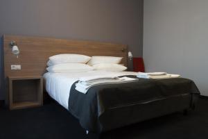 Кровать или кровати в номере Отель Эра Cпа