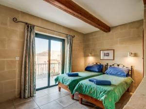 A bed or beds in a room at Gozo Escape