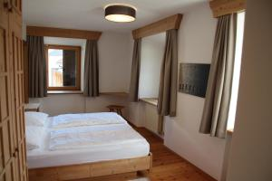 Ein Bett oder Betten in einem Zimmer der Unterkunft Hotel Greif