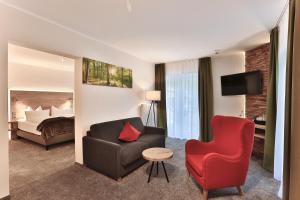 Ein Sitzbereich in der Unterkunft Elements Hotel Christlessee
