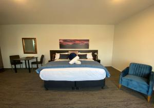 A bed or beds in a room at Pukaki Luxury Suites