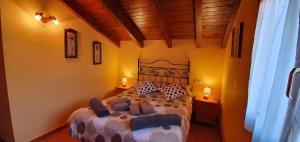 Cama o camas de una habitación en Turismo Rural Castell