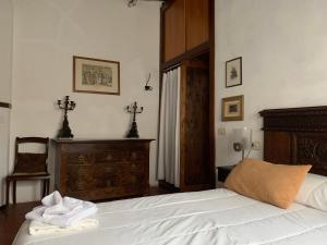 Letto o letti in una camera di Antiche Dimore Vescovado