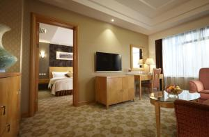 A television and/or entertainment center at Dalian East Hotel