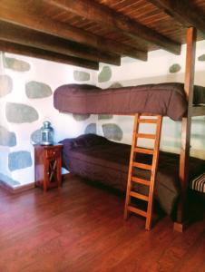 Litera o literas de una habitación en Rural Suite Santiago de Tunte