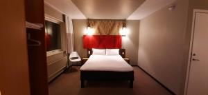 A bed or beds in a room at Sure Hotel by Best Western Spånga