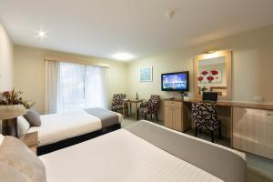 A television and/or entertainment center at ibis Styles Canberra