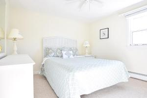 A bed or beds in a room at #505 - Beach Rose