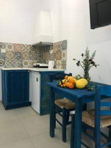 A kitchen or kitchenette at Filoxenia Apartments & Studios