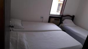A bed or beds in a room at Casa de praia da maria Luiza