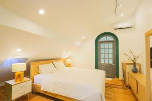 A bed or beds in a room at THI Boutique Villa
