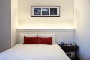 A bed or beds in a room at 53 Hotel
