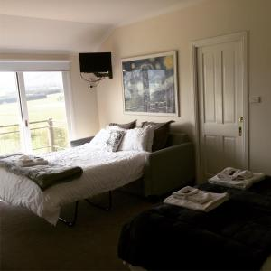 A bed or beds in a room at Rosewhite House