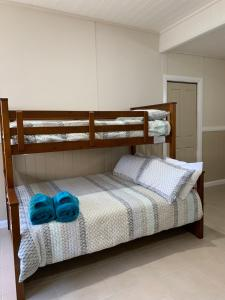 A bunk bed or bunk beds in a room at The Convent Boutique Accommodation & Cafe