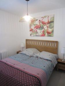 A bed or beds in a room at Appartement Vue sur la Mer, Saintes Maries de la Mer