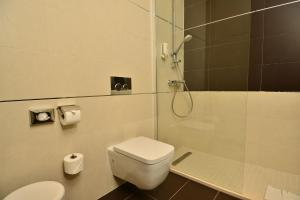 A bathroom at Celenga Apartments with Free Parking