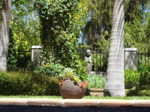 Een tuin van African Palm Cottage