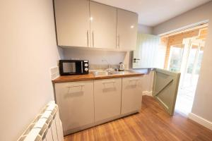 A kitchen or kitchenette at Moors Wood HotTub Retreat