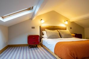A bed or beds in a room at The Vineyard Lamberhurst