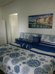 Cama ou camas em um quarto em Palm Trees Apartments