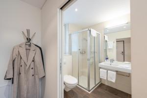 Ein Badezimmer in der Unterkunft Hotel Rössli