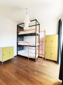 A bunk bed or bunk beds in a room at Tric Trac Hostel