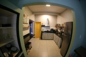 A kitchen or kitchenette at Um Hostel
