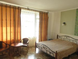 A bed or beds in a room at Guest House Sakhalin