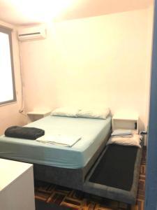 A bed or beds in a room at Apt central , 1 dormitório para até 6 pessoas