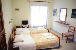 Ένα ή περισσότερα κρεβάτια σε δωμάτιο στο Marylin