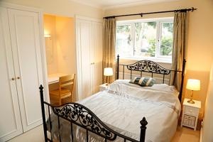 A bed or beds in a room at Orchard House