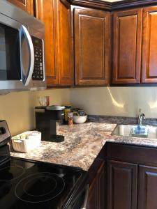 A kitchen or kitchenette at 561 Notre Dame St Apartment