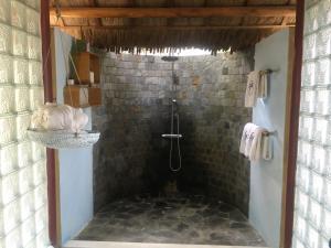 Ein Badezimmer in der Unterkunft Le Domaine De Tam Hai Resort