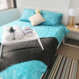 A bed or beds in a room at ReadySet Apartments at Upper West Side