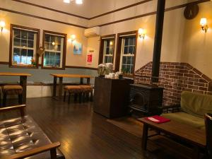 The lounge or bar area at IZA Kamakura Guest House and Bar