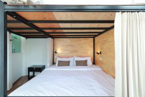 Ein Bett oder Betten in einem Zimmer der Unterkunft OYO 552 Hab40 Hostel